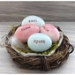 Personalized ceramic eggs in a nest celebrates family - Elise Thomas Designs