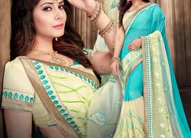 Pleasing Sky Blue Georgette Trendy Saree Having Surplice Neckline