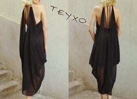 Feel the untamed spirit of summer in this black backless dress from Teyxo!