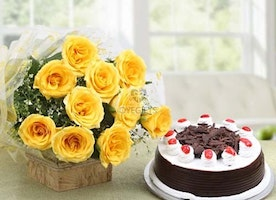 12 Yellow Roses in a cellophane packing with yellow ribbon and 500 grams Blackforest Cake - OyeGifts.com