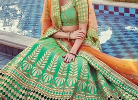 ORANGE AND SEA GREEN BEADS WORK A LINE LEHENGA CHOLI