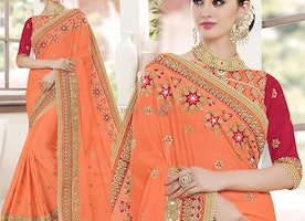 Orange Matching Bordered Half Sleeved Blouse With Designer Saree