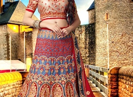 Enticing Patch Border Work Net Bridal Lehenga Choli