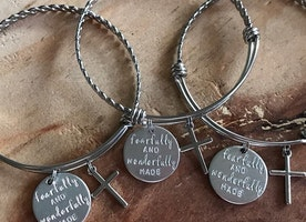 Silver bangle with custom charms