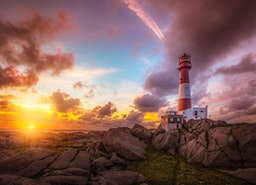 Lighthouse durind Sunset Wall Mural