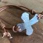 Sideways cross adjustable bracelet