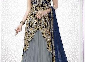 Magnetic Blue Asymmetrical Net N Velvet Wedding Lahenga By Designersandyou
