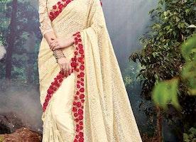 Divine Cream Heavy Worked Net Designer Saree For Wedding