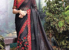 Prepossessing Black Heavy Worked Net Saree For Reception