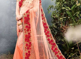 Striking Peach Heavily Embellished Net Saree For Engagement