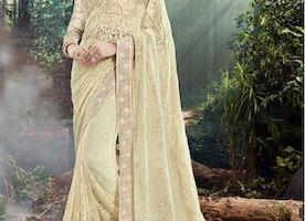 Lovable Cream Heavily Embellished Georgette Sari For Engagement