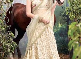 Enchanting Cream Heavily Embellished Net Latest Designer Lehenga For Bride