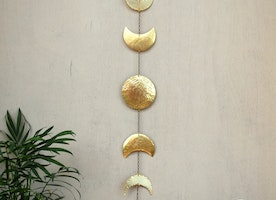 Moon phases brass wall hanging