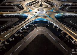 Beijing's Daxing International Airport Model with Zaha Hadid's process and challenges.