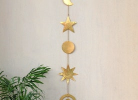 Celestial brass wall hanging
