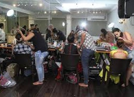 What does makeup artists do on film and television sets?