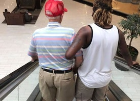 Photo of Young Man Helping Elderly Gentleman Down an Escalator Goes Viral