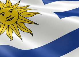 What is the main language spoken in Uruguay?