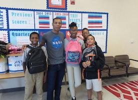 Derek Bluford donates to neighborhood underserved schools
