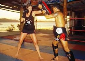 Women Enjoying Muay Thai Training in Thailand and weight loss in this summer