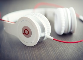 Does listening to music at work improve productivity?