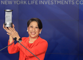 New York Life Investment Management's Yie-Hsin Hung rings the Nasdaq opening bell