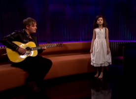 "7-Year-Old Girl Stuns the Audience with Sinatra's ""Fly Me to the Moon"""