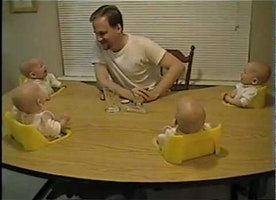 Watch How This Dad Hilariously Keeps His Quadruplets Entertained Simultaneously