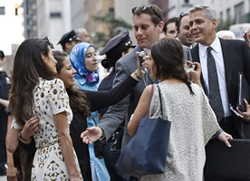 The most precious picture of the day: George Clooney being overshadowed by his Fierce Wife, Amal