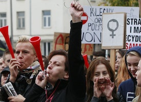 Thousands of women across Poland refuse to work in all-out strike against abortion ban