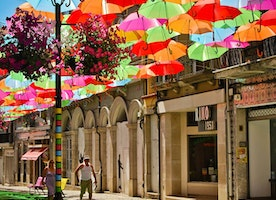 ÁGUEDA'S BRIGHTLY COLORED UMBRELLA-STREETS
