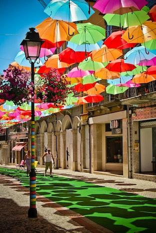 ÁGUEDA'S BRIGHTLY COLORED UMBRELLA-STREETS