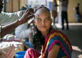 These Stunning Images Show Indian Women Shaving Their Heads For Religion