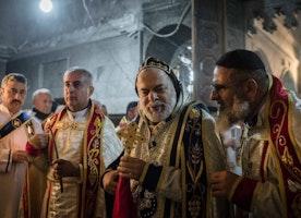 Displaced Iraqis return home for 'wartime' Christmas mass