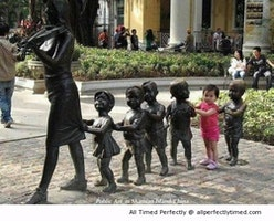 Kid joining the art formation – The statue is missing something, so why not make it complete.