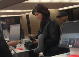 This Picture Of A Woman At An Airport Is Going Viral. Look Closer And You'll See Why.