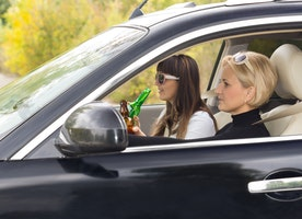 Is It Legal For Passengers To Drink In A Moving Vehicle?