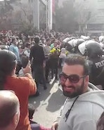 Iran protesters hand flowers to the police as the internet is shut off